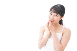 恋をする笑顔の若い女性の写真素材 [FYI04727844]