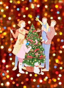 クリスマスツリーと家族とイルミネーションの写真素材 [FYI04731370]