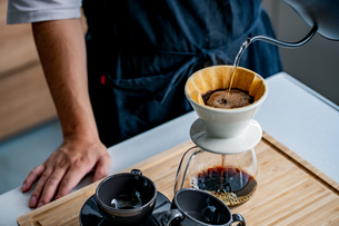 Man making coffee in the kitchen. Delicious coffee image.の写真素材 [FYI04733708]