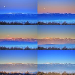 高ボッチ高原から望む朝日に染まる穂高連峰と沈みゆく満月の写真素材 [FYI04756603]