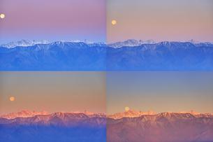 高ボッチ高原から望む朝日に染まる穂高連峰と沈みゆく満月の写真素材 [FYI04756615]
