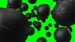 Many black basketball balls on green chroma key. Abstract 3d illustration for background.のイラスト素材 [FYI04773176]