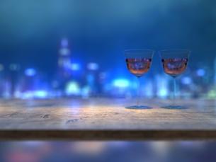 カウンターテーブルとワイングラスと都市の夜景のイラスト素材 [FYI04805859]