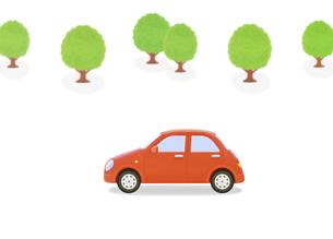 赤い車と樹木の写真素材 [FYI04808895]