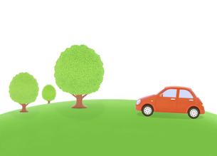 丘の樹木と赤い車の写真素材 [FYI04808911]