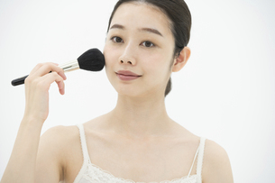 化粧・ブラシ・女性の写真素材 [FYI04834267]