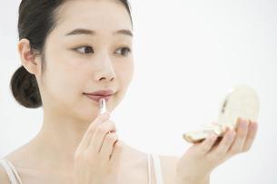 化粧・口紅・女性の写真素材 [FYI04835397]