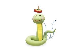 頭にコマをのせて自慢するヘビの写真素材 [FYI04837016]