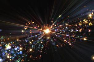 光のパーティクルと放射光のアブストラクト背景のイラスト素材 [FYI04838606]