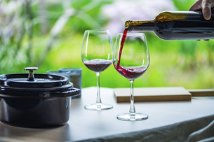 Two glasses of red wine on a table.Modern lifestyle image.の写真素材 [FYI04866315]