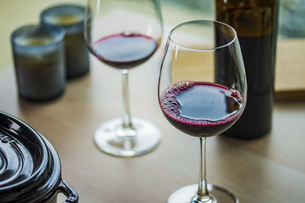 Two glasses of red wine on a table.Modern lifestyle image.の写真素材 [FYI04866318]