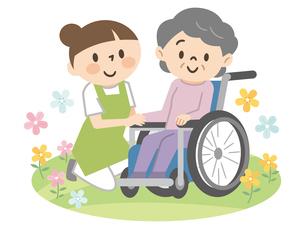 車椅子のシニア女性と若い介護スタッフのイラスト素材 [FYI04866408]