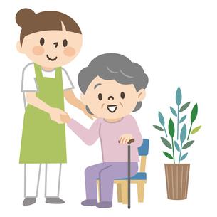 立ち上がる高齢女性を支える介護士のイラスト素材 [FYI04867401]