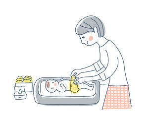 赤ちゃんのおむつ替えをするママのイラスト素材 [FYI04871290]