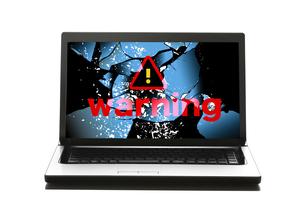 パソコンと警告マークの写真素材 [FYI04884311]