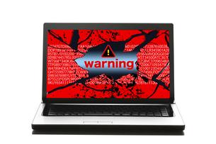 パソコンと警告マークの写真素材 [FYI04884328]