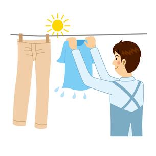 洗濯物を干す男性のイラスト素材 [FYI04897710]