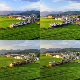 上田電鉄本社と田園と夕日に輝く別所線の電車の写真素材 [FYI04915383]