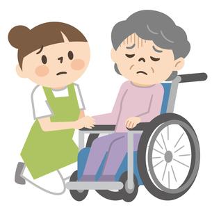 落ち込んだ感情の車椅子に乗ったシニア女性と寄り添う女性介護士のイラスト素材 [FYI04918822]